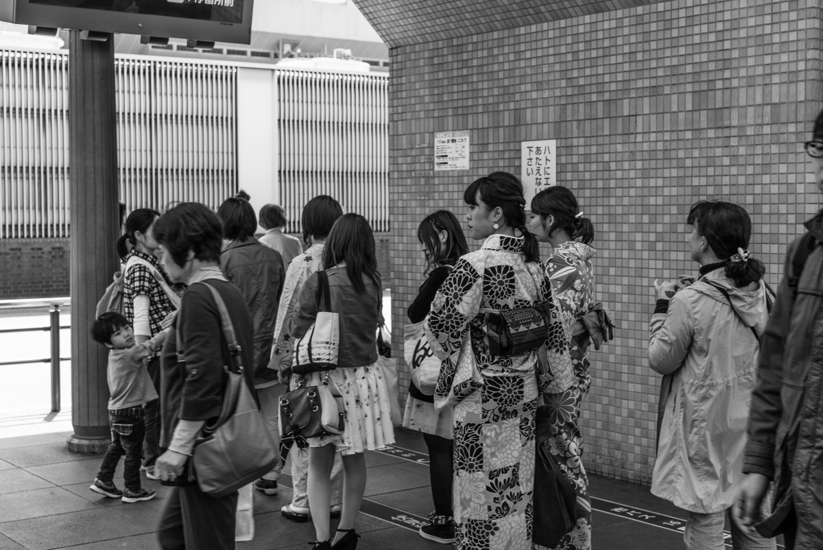 Waiting in line for the train in Japan